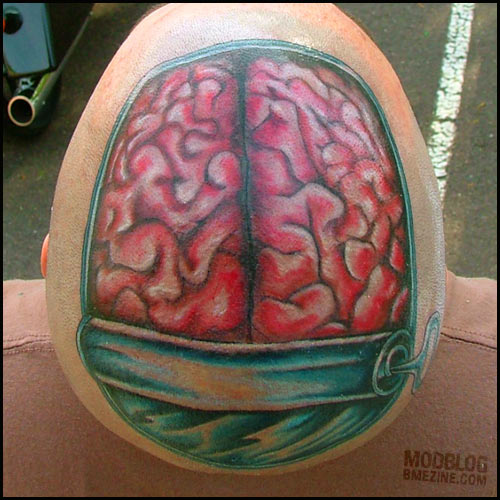 puzzle tattoo. brain tattooed